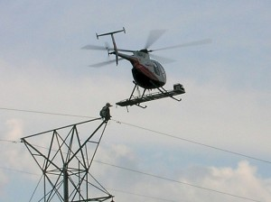 Helicopter by Power Transmission Lines (Source: Flicker user, b0jangles, at www.wjon.com)